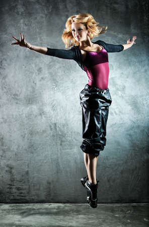 woman flying: Young woman dancer. On wall background.