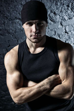 Young strong man portrait. Contrast colors. Stock Photo - 8016862