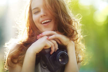 Young woman photographer. Soft colors, focus on mouth. photo