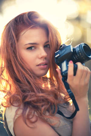 photographers: Young woman photographer. Soft colors and shallow doff.