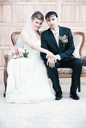 Young wedding couple interior portrait. Bright white colors. photo