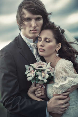 Young wedding couple tender portrait. photo