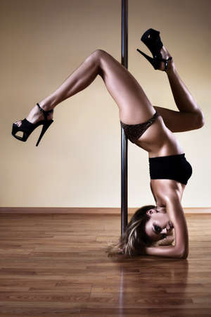 Young sexy pole dance woman. Contrast colors. photo