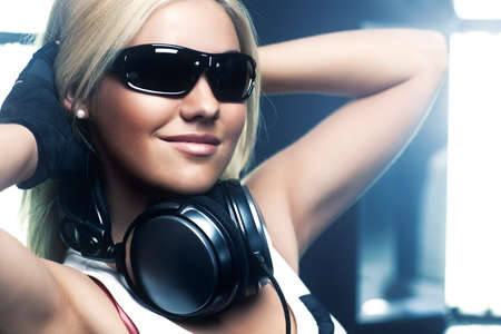 Young woman dancer with headphones and sunglasses portrait. photo