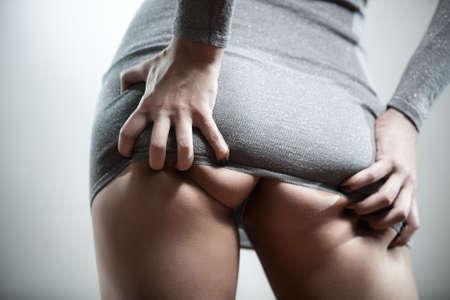 nalga: Mujer sexy volver con las manos.  Foto de archivo