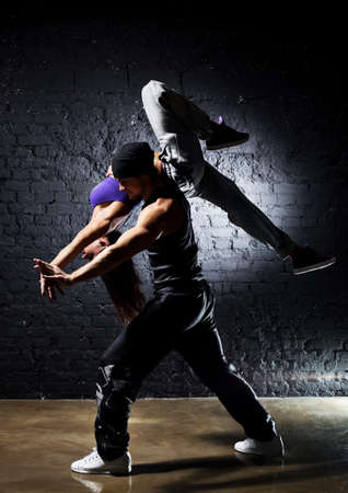 hip hop dancing: Dancer couple. Contrast colors effect.