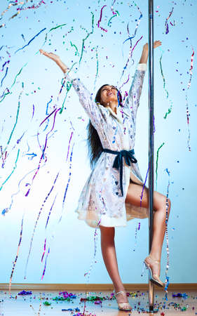 Young pole dance woman in new year clothes celebrating. photo