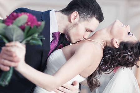 Young wedding couple kissing. Bright white colors. photo