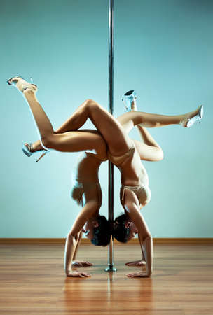 Two young sexy pole dance women. photo