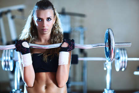 Weight training young woman portrait. photo