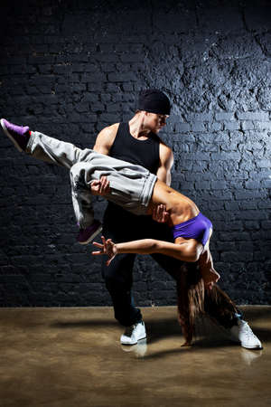 Dancer couple. Contrast colors effect. photo