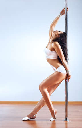 Young slim pole dance woman. photo