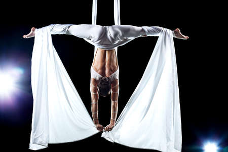 Young woman gymnast. On black background with flash effect. Stock Photo - 8706169