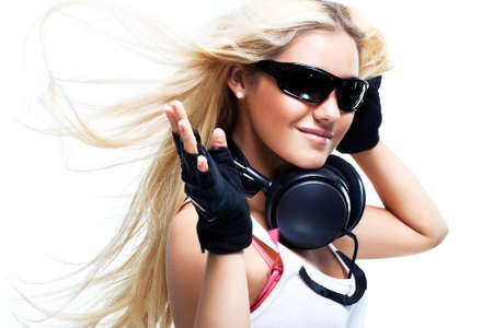 windy energy: Young woman with big headphones. Isolated on white. Stock Photo