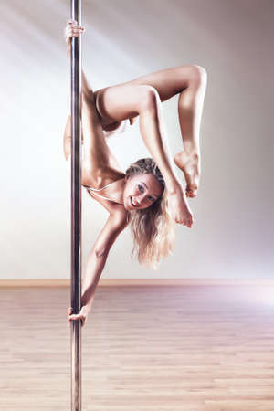poledance: Young slim pole dance woman.