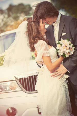 Young wedding couple portrait. Retro style colors. photo