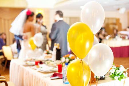 feast table: Wedding celebration abstract. Focus on balloons. Stock Photo