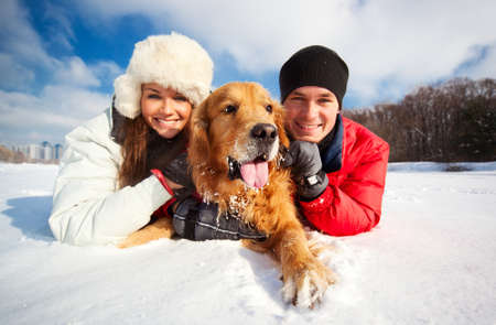 winter couple: Young couple portrait with dog