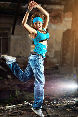 ruinous: Young woman dancing on industrial background. Stock Photo