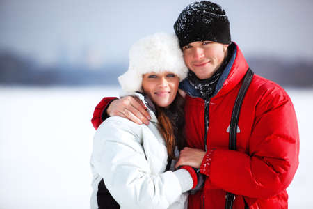 couple winter: Young couple winter outdoors portrait. Stock Photo
