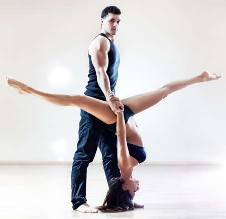 Dancer couple. On bright background. photo