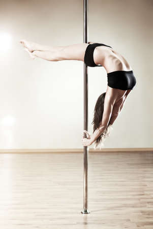 female gymnast: Young slim pole dance woman.