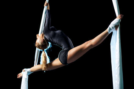 Young woman gymnast. On black background. Stock Photo - 9398163