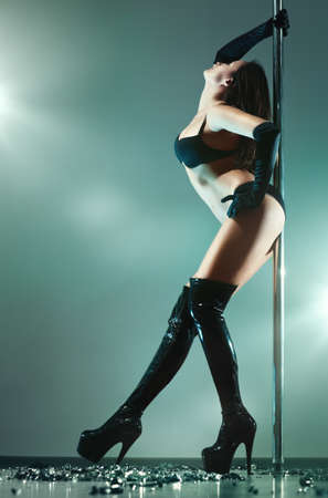 Young sexy pole dance woman. Stock Photo - 9463368