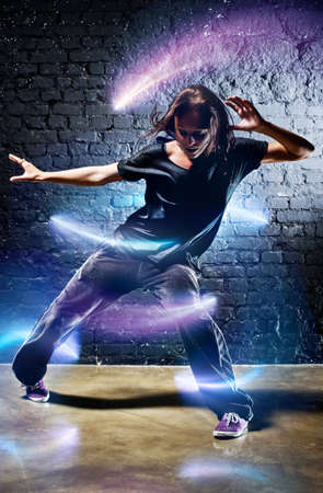 hip hop dancing: Young woman dancer. With lights effect.