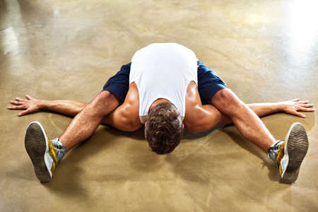 Young man sports stretching exercises. photo