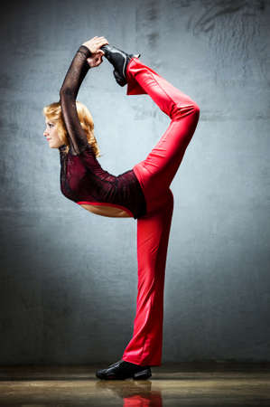 Young woman dancer. On wall background. Stock Photo - 9969672