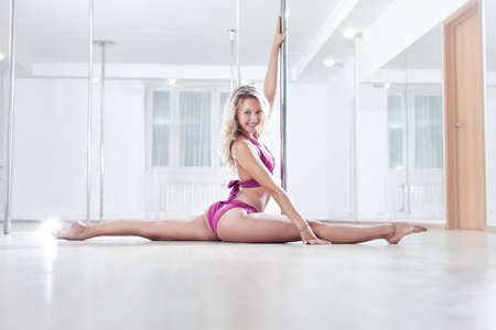 poledance: Young pole dance woman. Bright white colors.