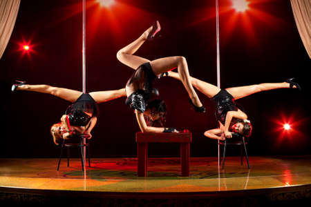 Three young women acrobatic show. photo