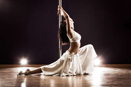 Young slim pole dance woman. Contrast colors. Stock Photo - 10117237