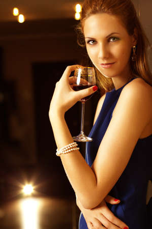 woman drinking wine: Young woman with glass of wine. Stock Photo