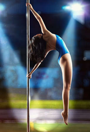 pole dance: Young sexy pole dance woman. Stock Photo