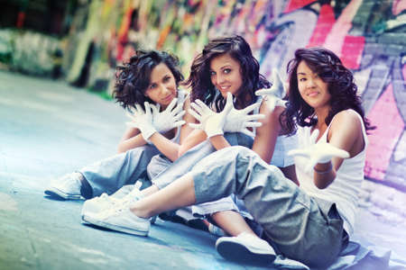 urban dance: Young women team. Focus on central woman.