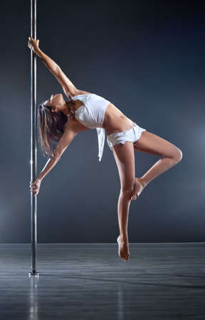 Young slim pole dance woman. Stock Photo - 11273050