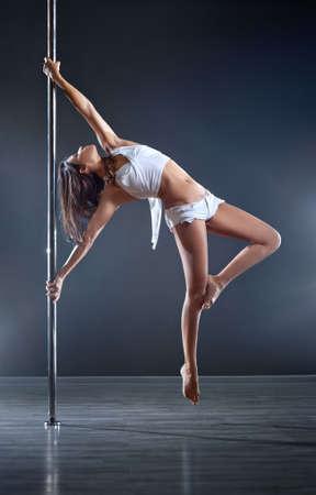 nude gymnast: Young slim pole dance woman.
