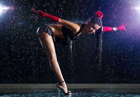 Young sexy woman dancer with water. photo