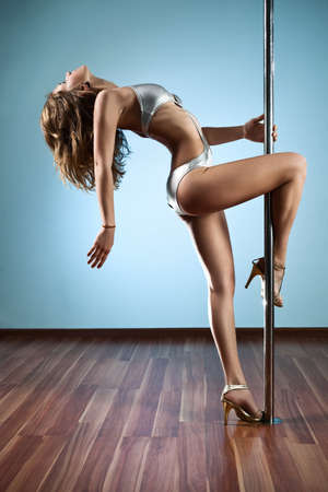 Young sexy pole dance woman. Stock Photo - 11744309