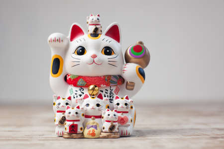 Maneki Neko cat. Common Japanese sculpture bring good luck to the owner. Stock Photo