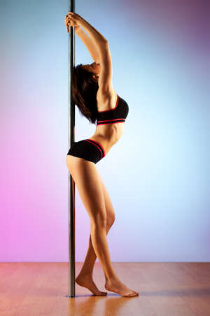 Young slim pole dance woman. Stock Photo - 11863928