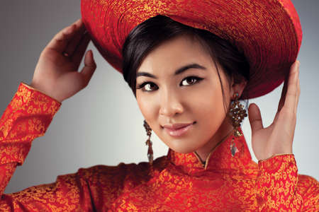 Young vietnamese woman in traditional clothing portrait. Stock Photo - 11863937