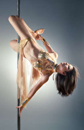 poledance: Young sexy pole dance woman. Stock Photo