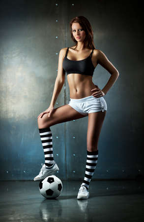 Young sexy woman football player.