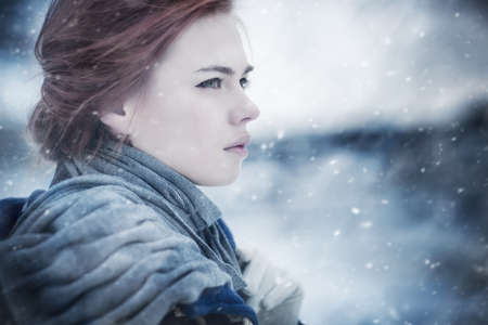 a blizzard: Young woman calm winter portrait. Stock Photo