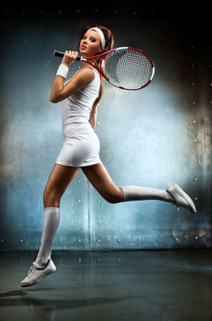 Young sexy tennis player woman running. Stock Photo - 12470111