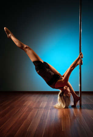 Young pole dance woman stretching