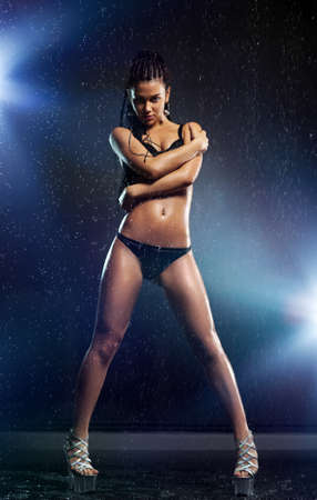 Young sexy woman dancer with water  photo